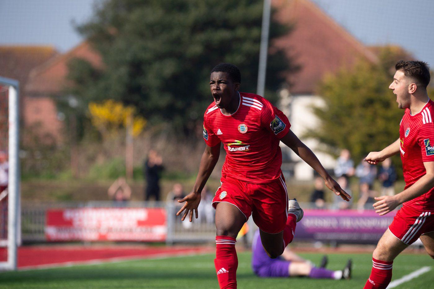 Kwame Poku celebrates scoring against Hornchurch at Woodside Road